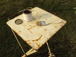 Table, brush and gold-leaf paint