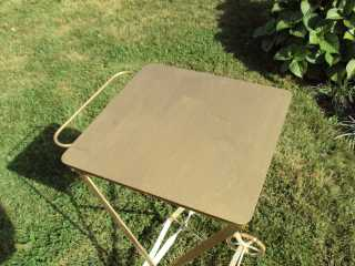Table in shade showing Roof Menders' gold liquid paint