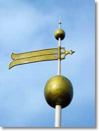 Gold liquid paint applied on weathervane